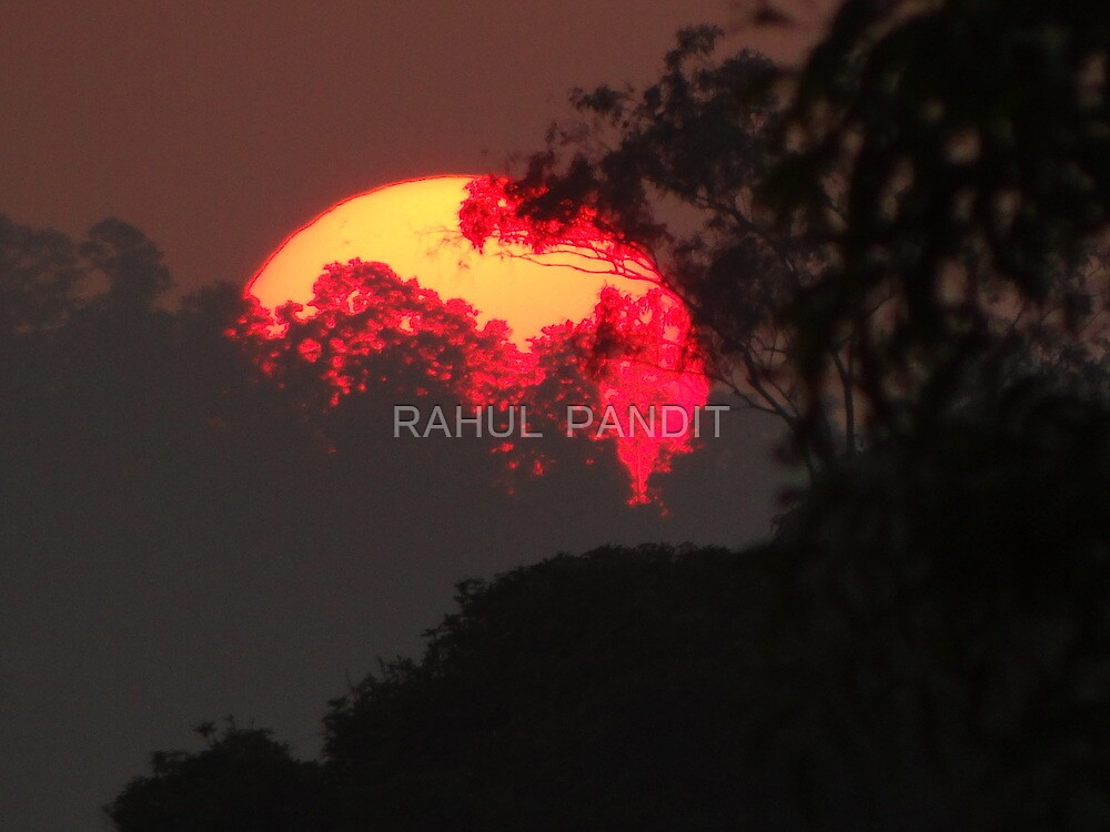 SUNSET DEPICTING CONTINENTS by RAHUL  PANDIT