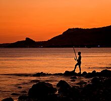 Lonely Fisherman At Sunset by Kuzeytac