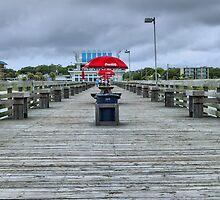 Unbrella on pier by Tom Causley