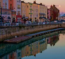 Sundown and Moonrise at Ramsgate Harbour by Dave Godden