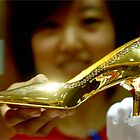 Gold shoe at auction by MacSmthg