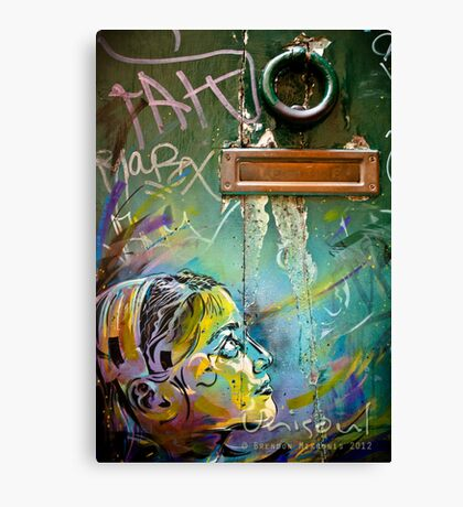 Colourful young girl on a door down a lane Canvas Print