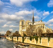 Boats on the Seine Passing Notre Dame by Mark Tisdale