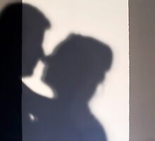 Silhouette of a kissing couple  by PhotoStock-Isra