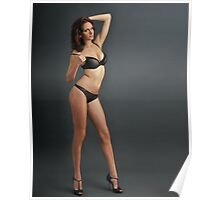 A young redhead woman posing sexy in transparent lingerie Poster