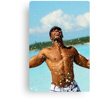Young man splashes water in the sea Canvas Print