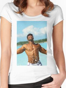Young man splashes water in the sea Women's Fitted Scoop T-Shirt
