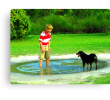 zack and the dog in a puddle Canvas Print