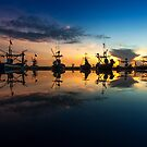 Fisherman Boat in Sunset by arthit somsakul