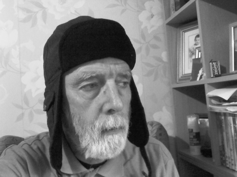 MAN IN RUSSIAN HAT IN BLACK AND WHITE by Terry Collett