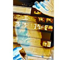 Photographer looks at a sheet of negatives Photographic Print