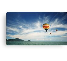Colorful hot air balloon flying over the sea Canvas Print