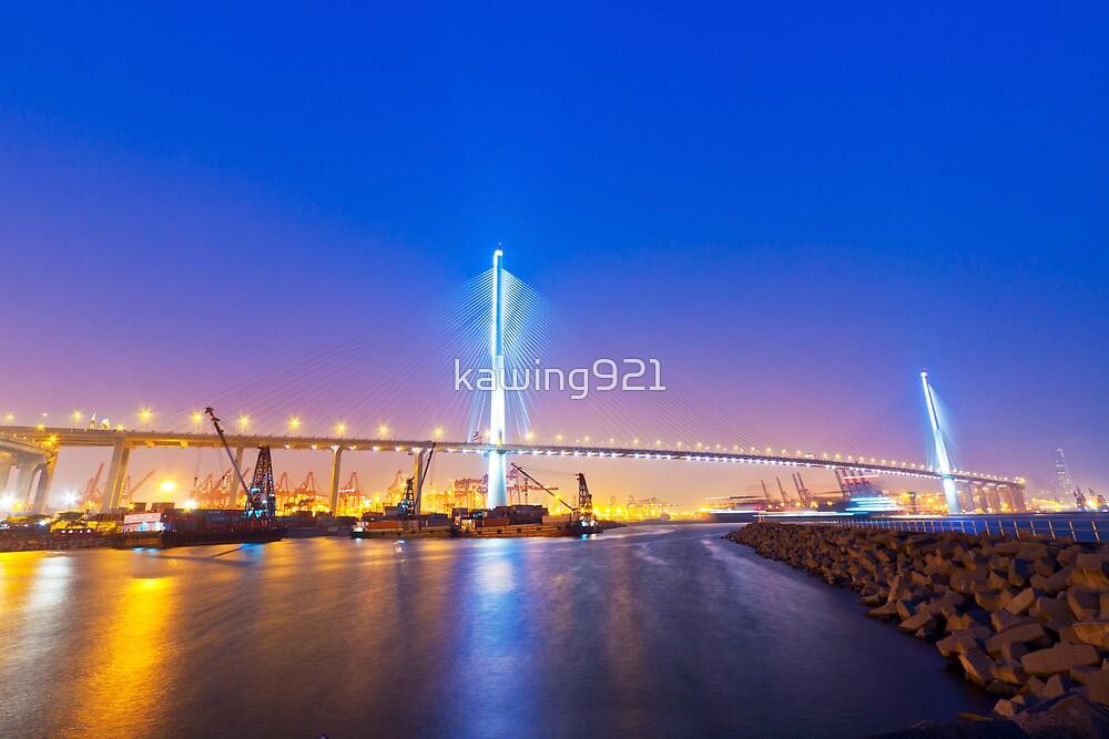 Hong Kong bridge at cargo terminal at night by kawing921