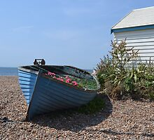 Small Boat on shingle by janlou