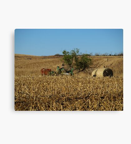 Straw Bales and Mower Canvas Print