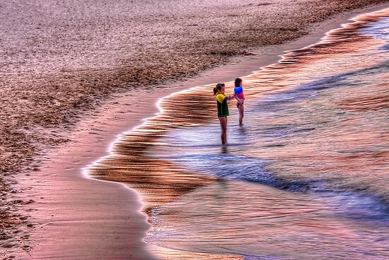 Girls loving the pretty pink sunset by Chris Brunton