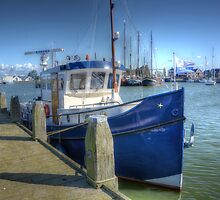 Blue fishingboat, no kidding! by Nicole W.