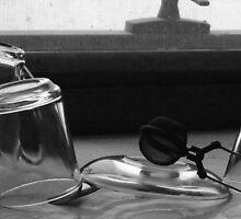 Tea cups, saucer, strainer by Adam Isaacson