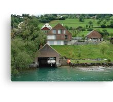 Boat house on the slope on Lake Lucerne Canvas Print