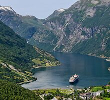 Cruise Ship Anchored in Geiranger Harbour Surrounded by Mountains  by Gerda Grice
