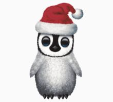 Baby Penguin Wearing a Santa Hat on Blue Kids Tee