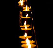 candles in an italian cathedral by Steve Shand