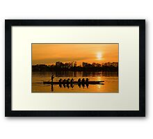 Group of people rowing to success Framed Print