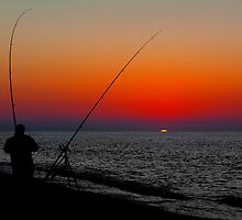 ANGLERS SILHOUETTED ON CLEY BEACH by Norfolkimages