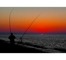ANGLERS SILHOUETTED ON CLEY BEACH Photographic Print