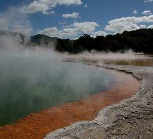 Champagne pool and cloud. Waiotapu. NZ by Ian Hallmond