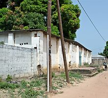Electricity power supply pole in Gambia village by Sue Robinson