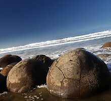 Moeraki boulders by Kyra  Webb