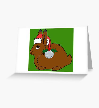 Brown Arctic Hare with Red Santa Hat, Holly & Silver Bell Greeting Card
