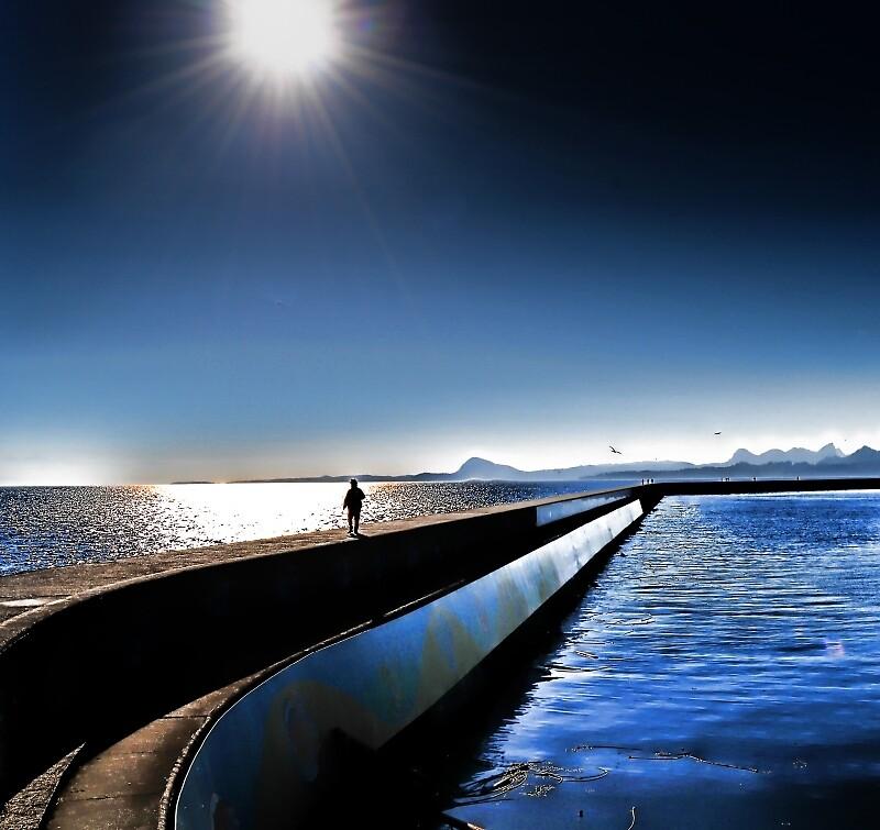 alone on a dock on a bay (not sitting) by marcwellman2000