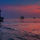 Silhouette Boat in beautiful sunrise by arthit somsakul