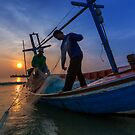 Sunset with fisherman work by arthit somsakul