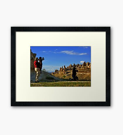 Tourists at work Framed Print