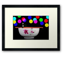 Circus balance game on chopsticks Framed Print