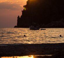 Last rays of sun reflect in the sea Sticker