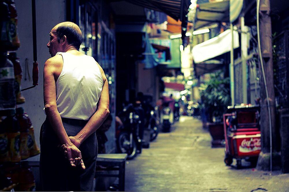 Old man, Saigon, Vietnam by bouche