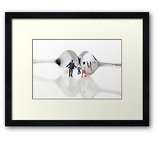 Family in front of spoon distoring mirrors II Framed Print