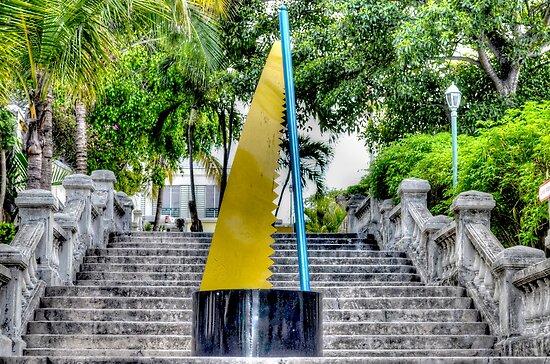 Rake n Scrape Sculpture Honours Bahamian Music on the Frederick Street steps in Nassau, The Bahamas by 242Digital