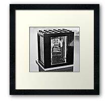 Stuck in the box Framed Print