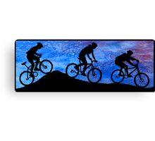 Three Mountain Bikers at Dusk Canvas Print
