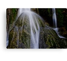 Waterfall flows over round rock, Vanuatu, South Pacific Ocean Canvas Print