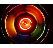 The lights spin as the beat goes on. Photographic Print