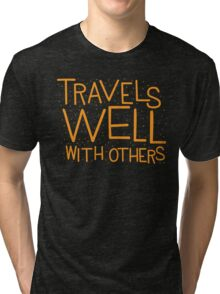 TRAVELS WELL WITH OTHERS Tri-blend T-Shirt