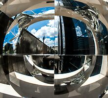 Reflection of building in an odd shaped mirror. by PhotoStock-Isra