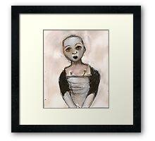 Stripped doll Framed Print