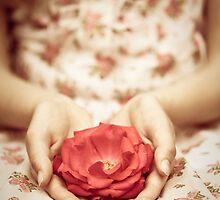 Rose in her hands by Maria Heyens